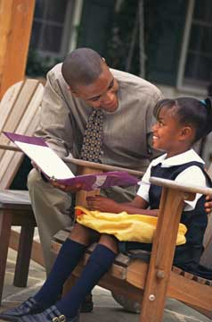 Dad reading a book to a child